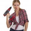 Funny beautiful young woman with a drill drills head — Stock Photo #8813948