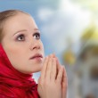 Beautiful young woman in a scarf prays to God — Stock Photo #8912002
