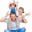 Cheerful family of three - Stock Photo