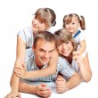 Cheerful family of four — Stockfoto