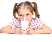 Beautiful girl drinking milk — Stock Photo