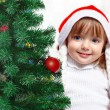 Beautiful girl dressed in a Santa Claus hat — Stock Photo