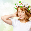 Beautiful woman in a wreath of flowers - Stock Photo