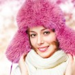 Woman in a warm hat - Stock Photo
