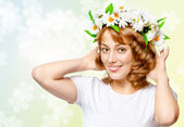 Beautiful woman in a wreath of flowers — Stock Photo