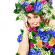 Portrait of a young woman wearing a crown of flowers - Stock Photo