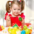 Girl paints eggs - Stock Photo