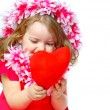 Portrait of a beautiful girl holding a heart - Stock Photo