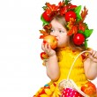 Little girl eating apples - Stock Photo