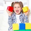 Girl playing with blocks — Stock Photo