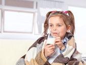 Beautiful girl drinking milk — Stock Photo
