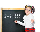 Girl standing at the blackboard, isolated — Stockfoto