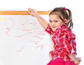Girl standing at the blackboard, isolated — Stock Photo