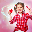 Little girl holding a heart - Stock Photo