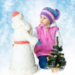 Portrait of a little girl sitting near a Christmas tree with San — Stok Fotoğraf #33877821