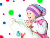 Portrait of a little girl holding santa claus, christmas, — Stock Photo