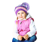 Beautiful little girl wearing a hat and jacket — Stock Photo