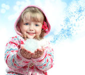 Portrait of a little girl holding a snow — Stock Photo