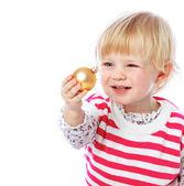 Portrait of a little girl holding a Christmas ball, celebration, — Stock Photo