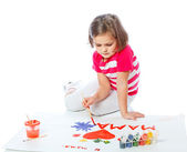 Little girl draws heart, paint, Valentine's Day, March 8 — Stock Photo