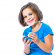 Stockfoto: Portrait of a little girl holding Easter eggs, holiday, Easter