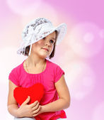 Little girl holding a heart — Stock Photo