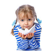 Portrait of a little girl holding a paper boat on a white backgr — Stock Photo