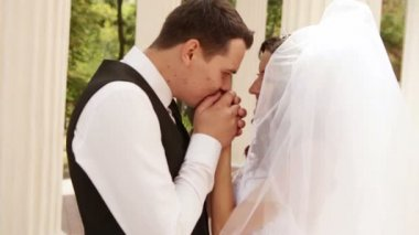 Groom kisses hands bride — Stock Video