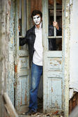 Guy mime against the old wooden door. — Stock Photo