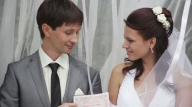 The bride and groom received a document of marriage — Stock Video
