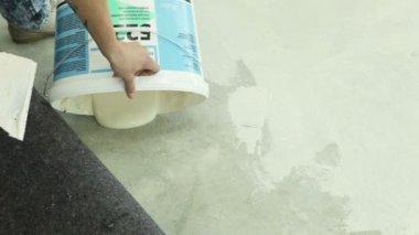 Glue for gluing carpet — Stock Video
