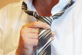 Tying a tie — Stock Photo