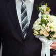 Groom with a bouquet — Stock Photo #24056385