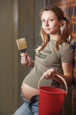 Pregnant woman builder — Stock Photo