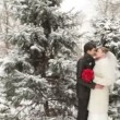 Couple in winter forest of snow-covered fir trees — Stock Video #31967811