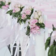Rows of white chairs decorated with pink ribbons — Stock Video #31968761