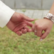 Stock Video: Bride and groom holding hands. bride holds wedding bouquet.