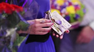 Guests with gifts and cards in the hands of waiting in line to congratulate — Stock Video