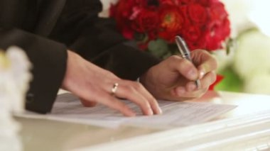 Bride and Groom Signing Marriage Certificate — Stock Video