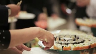 Guests take sushi on a festive cocktail party — Stock Video