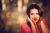 Girl with a flower in his mouth — Photo
