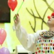 At a children's party clown makes big bubbles — Stock Video