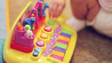 Child playing on a plastic toy piano — Stock Video