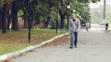 Cute young guy walks — Stock Video