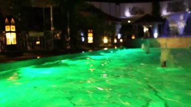 Colored lights at night pool — Stock Video