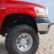 A front part of the offroad vehicle is photographed closeup in the dunes. — Stock Photo