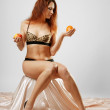 Stock Photo: Undressed womwith fruit