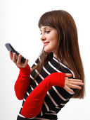 Amused girl with mobile phone close-up — Stock Photo