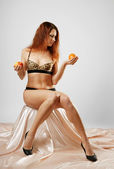 Undressed woman with fruit — Stock Photo