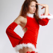 Female Santa in sexual red dress on light background — Foto Stock